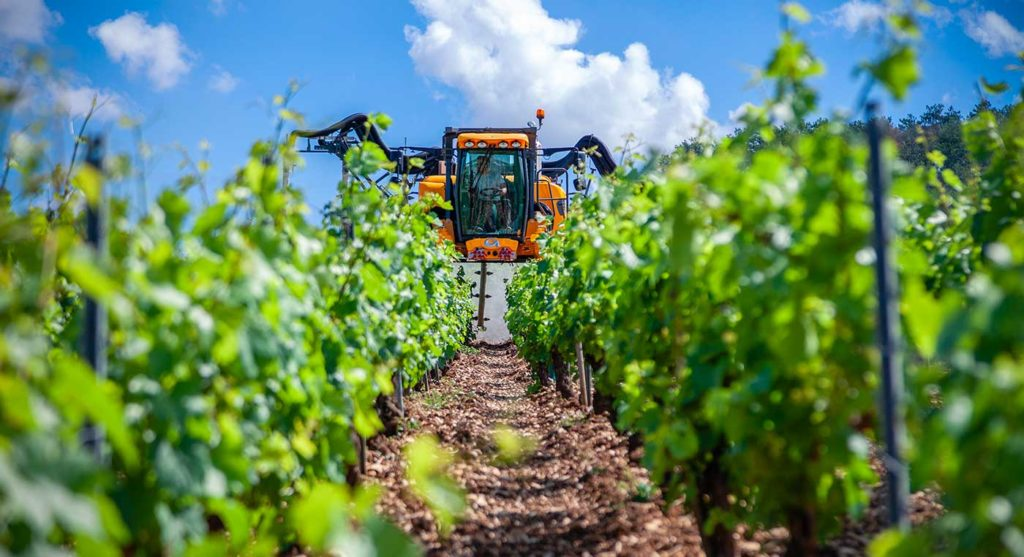 Vineyard machine using AIC technology to control fuel consumption.